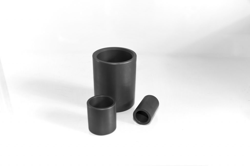 an image of three carbon graphite bearings, carbon bushings, carbon bearings
