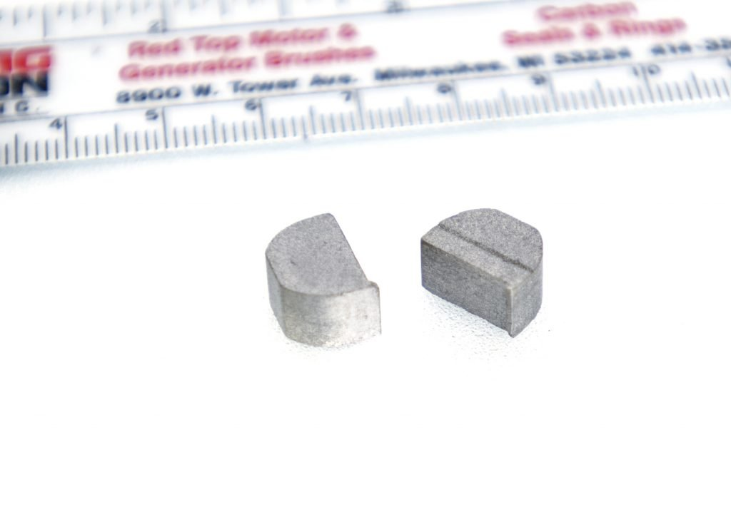 silver (for a silver graphite brush) next to a ruler
