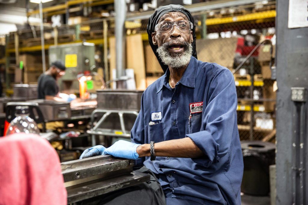 Copyrighted 2018 Ken Cooper. An older man works in the factory at Helwig Carbon.